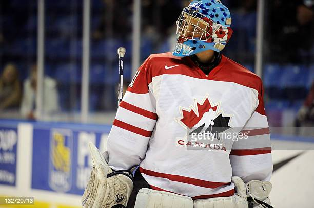 Adrian Ignagni of Canada East dejected after Alex Kerfoot of Canada West scores on him at World Junior A Challenge at Langley Events Center on...