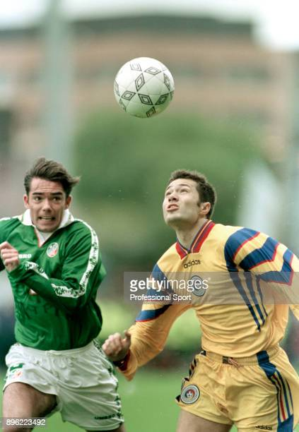 Adrian Ilie of Romania and Jeff Kenna of the Republic of Ireland in action during a 1998 FIFA World Cup Qualifier at Lansdowne Road on October 11...
