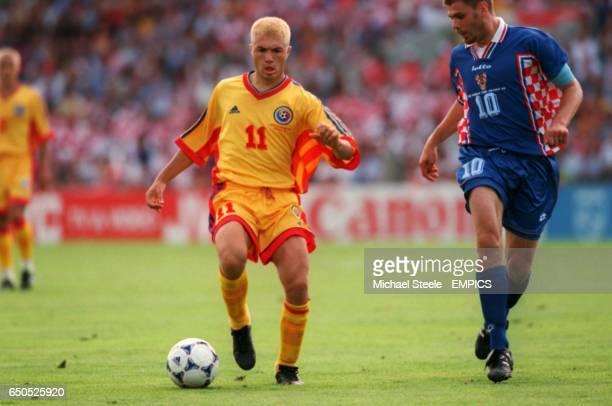 Adrian Ilie of Romania is shadowed by Croatia's Zvonimir Boban