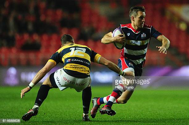 Adrian Jarvis of Bristol Rugby looks to break past Steve Shingler of Cardiff Blues during the European Rugby Challenge Cup between Bristol Rugby and...