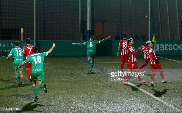 Adrian Jimenez Gomez of Cornella celebrates after scoring his sides first goal during the Copa del Rey match between Cornella and Atletico de Madrid...
