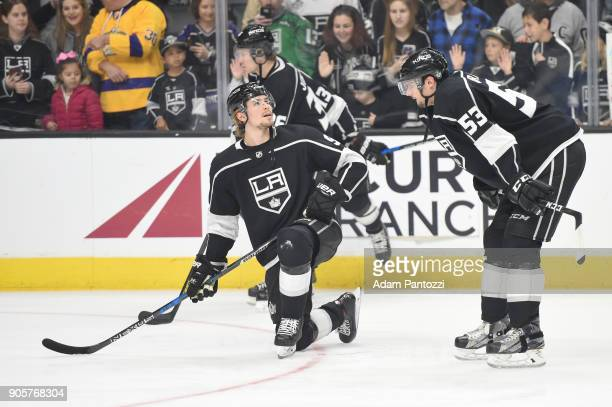 Adrian Kempe and Kevin Gravel of the Los Angeles Kings converse before a game against the San Jose Sharks at STAPLES Center on January 15 2018 in Los...