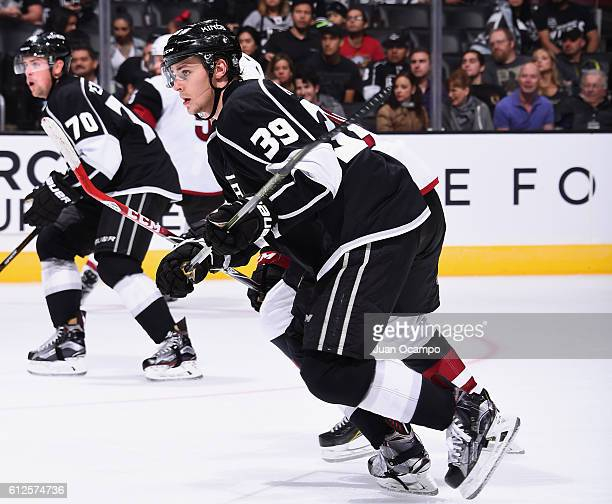 Adrian Kempe and Tanner Pearson of the Los Angeles Kings skate during a preseason game against the Arizona Coyotes on September 26 2016 at Staples...