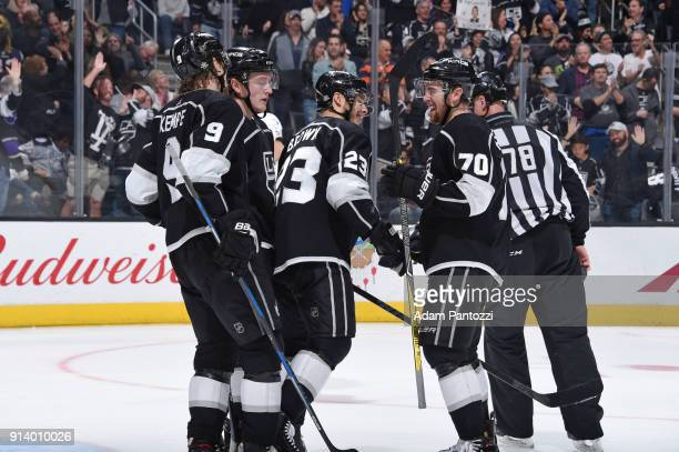 Adrian Kempe Dustin Brown and Tanner Pearson of the Los Angeles Kings celebrate after scoring a goal against the Arizona Coyotes at STAPLES Center on...