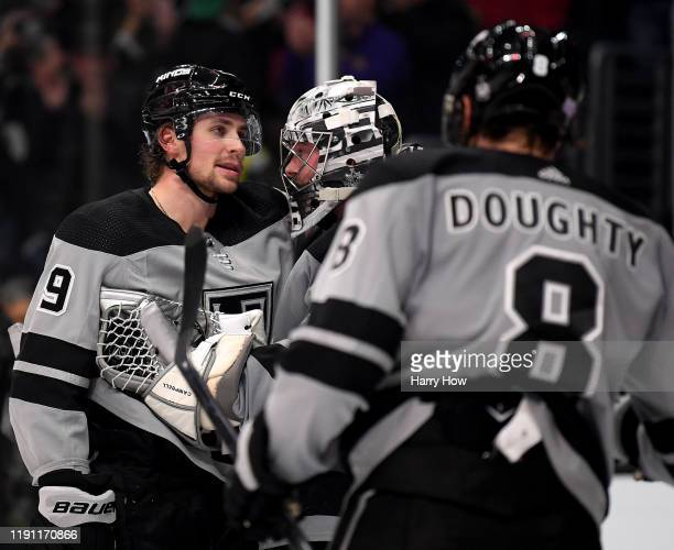 Adrian Kempe, Jack Campbell and Drew Doughty of the Los Angeles Kings reacts to the final whistle in celebration of a 2-1 Kings win over the Winnipeg...