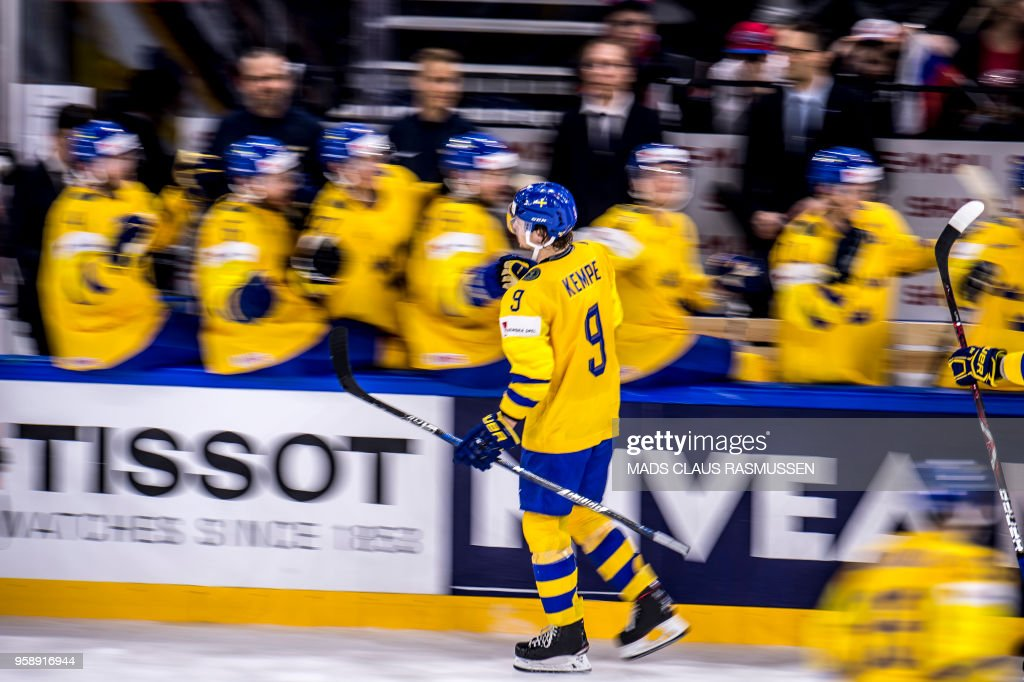 TOPSHOT - Adrian Kempe of Sweden celebrates with his temmates after a scoring during the group A match Russia v Sweden of the 2018 IIHF Ice Hockey World Championship at the Royal Arena in Copenhagen, Denmark, on May 15, 2018. (Photo by Mads Claus Rasmussen / Ritzau Scanpix / AFP) / Denmark OUT