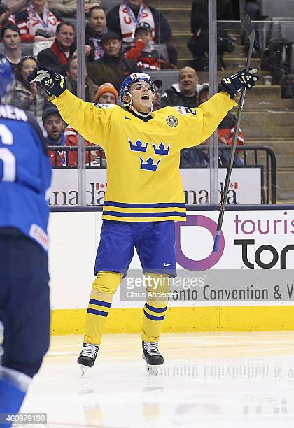 Adrian Kempe of Team Sweden celebrates his goal against Team Finland during a quarterfinal game in the 2015 IIHF World Junior hockey championship at...