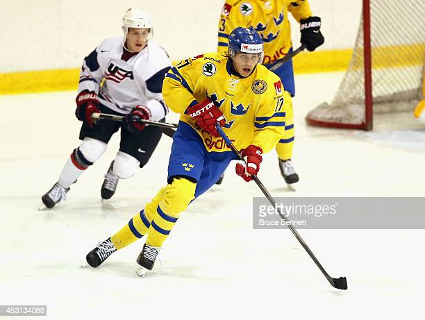 Adrian Kempe of Team Sweden skates against USA White during the 2014 USA Hockey Junior Evaluation Camp at the Lake Placid Olympic Center on August 3...