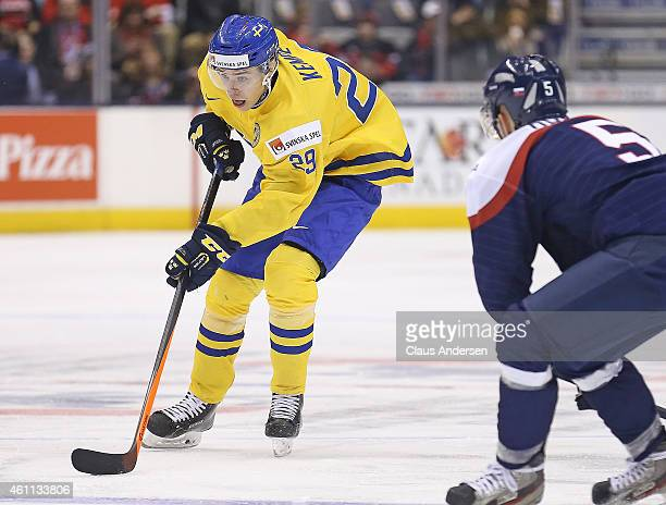 Adrian Kempe of Team Sweden skates with the puck against Team Slovakia during the Bronze medal game in the 2015 IIHF World Junior Hockey Championship...