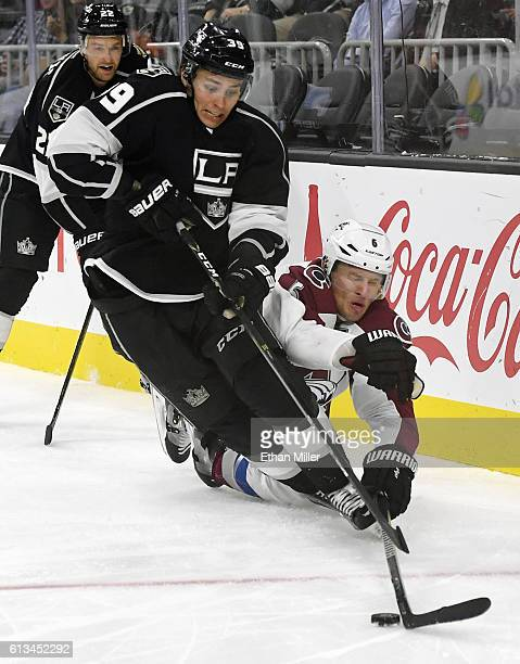 Adrian Kempe of the Los Angeles Kings and Erik Johnson of the Colorado Avalanche fight for the puck behind the net during their preseason game at...