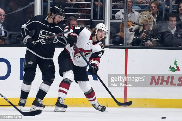 Adrian Kempe of the Los Angeles Kings and Mario Kempe of the Arizona Coyotes battle for the puck during the first period of the game at STAPLES...
