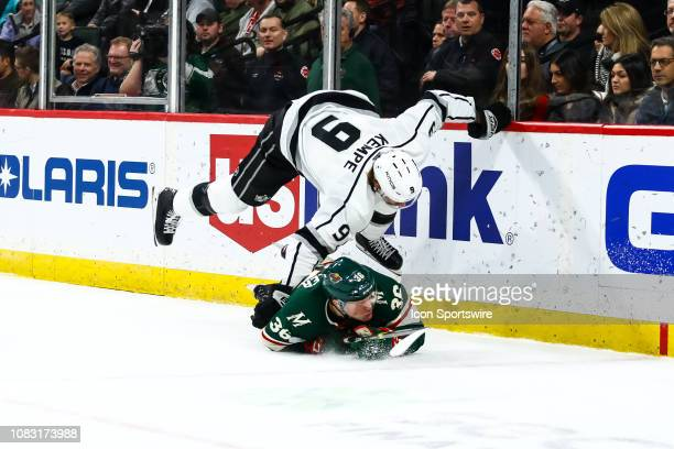 Adrian Kempe of the Los Angeles Kings and Nick Seeler of the Minnesota Wild fall to the ice in the first period at Xcel Energy Center on January 15...