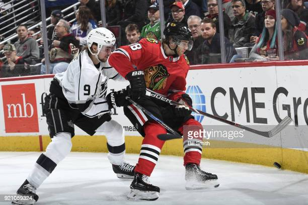 Adrian Kempe of the Los Angeles Kings and Patrick Kane of the Chicago Blackhawks chase the puck in the third period at the United Center on February...