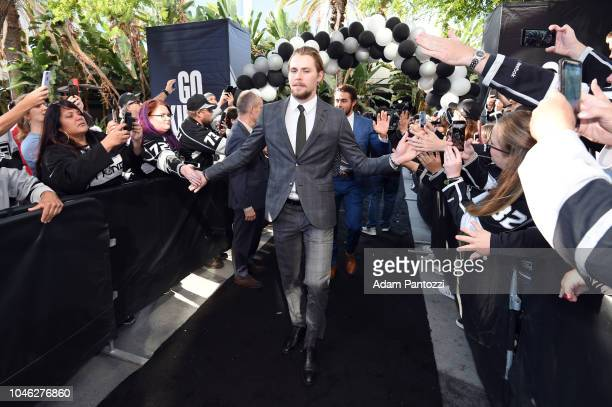 Adrian Kempe of the Los Angeles Kings arrives on the Black Carpet before a game against the San Jose Sharks at STAPLES Center on October 5 2018 in...