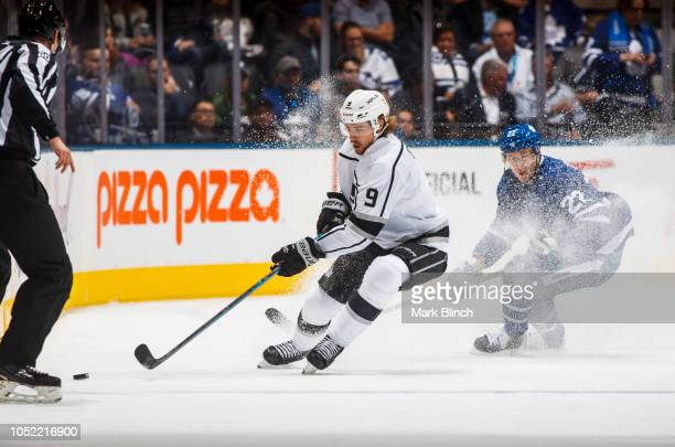 Adrian Kempe of the Los Angeles Kings battles for the puck against Nikita Zaitsev of the Toronto Maple Leafs during the first period at the...