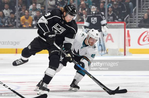Adrian Kempe of the Los Angeles Kings battles for the puck against Mikkel Boedker of the San Jose Sharks at STAPLES Center on November 12 2017 in Los...