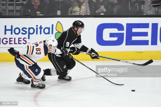 Adrian Kempe of the Los Angeles Kings battles for the puck against Matt Benning of the Edmonton Oilers at STAPLES Center on February 24 2018 in Los...