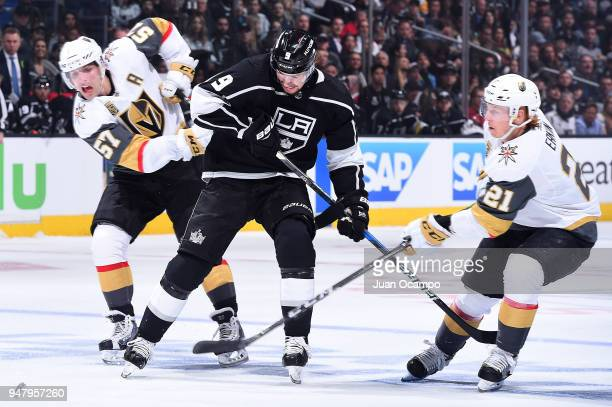 Adrian Kempe of the Los Angeles Kings battles for the puck against David Perron and Cody Eakin of the Vegas Golden Knights in Game Four of the...