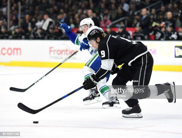 Adrian Kempe of the Los Angeles Kings breaks out as he is chased by Brock Boeser of the Vancouver Canucks at Staples Center on November 14 2017 in...