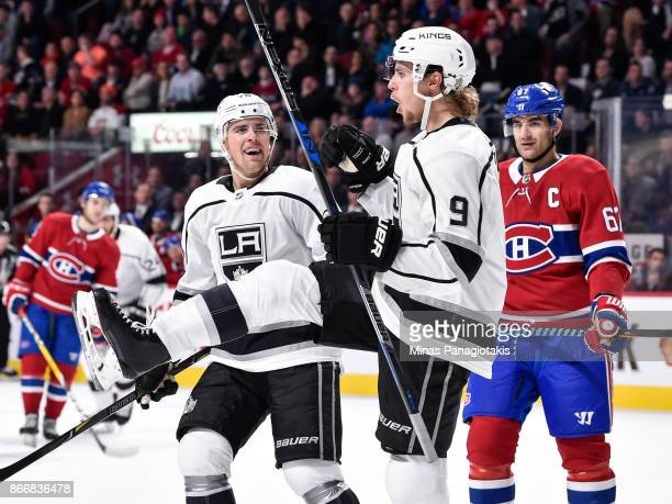 Adrian Kempe of the Los Angeles Kings celebrates his first period goal while teammate Tanner Pearson and Max Pacioretty of the Montreal Canadiens...