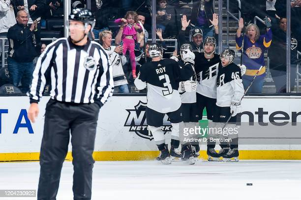 Adrian Kempe of the Los Angeles Kings celebrates his game-winning goal in overtime against the New Jersey Devils with Matt Roy, Sean Walker and Blake...