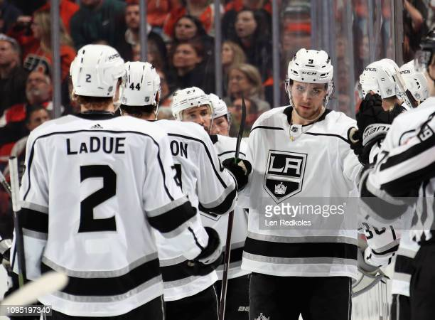 Adrian Kempe of the Los Angeles Kings celebrates his second period goal against the Philadelphia Flyers with his teammates on the bench on February 7...