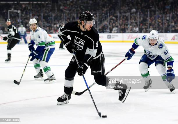Adrian Kempe of the Los Angeles Kings controls the puck in front of Sven Baertschi and Michael Del Zotto of the Vancouver Canucks during the first...