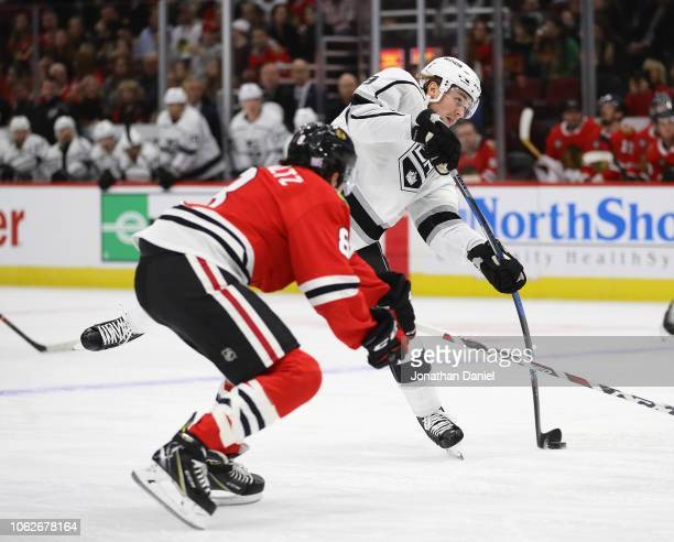 Adrian Kempe of the Los Angeles Kings fires a shot past Nick Schmaltz of the Chicago Blackhawks at the United Center on November 16 2018 in Chicago...