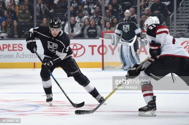 Adrian Kempe of the Los Angeles Kings handles the puck against Derek Stepan of the Arizona Coyotes at STAPLES Center on February 3 2018 in Los...