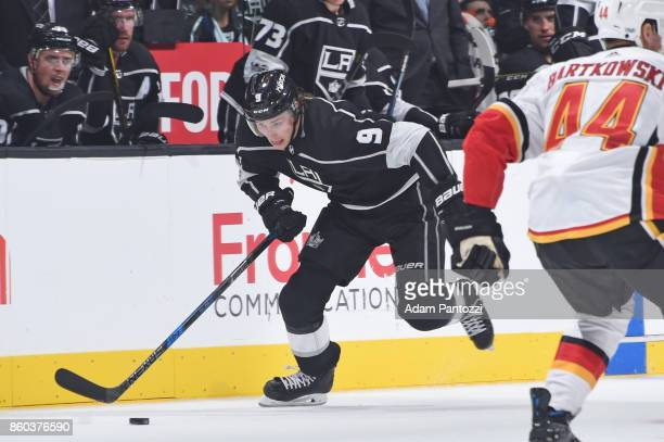 Adrian Kempe of the Los Angeles Kings handles the puck during a game against the Calgary Flames at STAPLES Center on October 11 2017 in Los Angeles...
