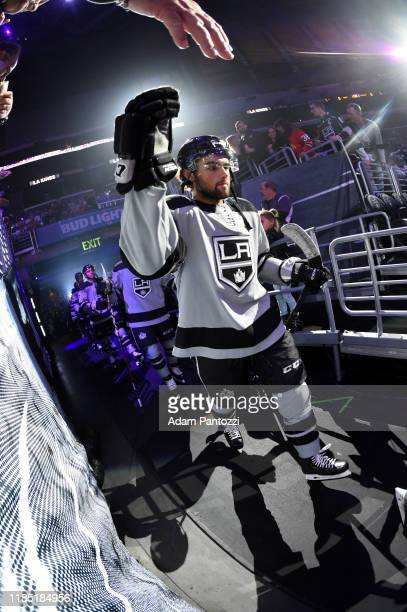 Adrian Kempe of the Los Angeles Kings high fives fans during the first period against the Chicago Blackhawks at STAPLES Center on November 02, 2019...