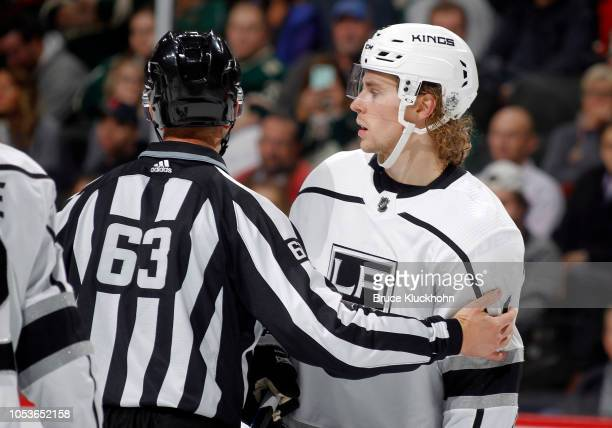 Adrian Kempe of the Los Angeles Kings is brought to the penalty box by Trent Knorr after being called for boarding in the 3rd period during a game...