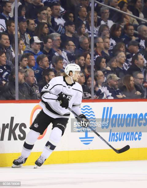 Adrian Kempe of the Los Angeles Kings keeps an eye on the play during second period action against the Winnipeg Jets at the Bell MTS Place on...