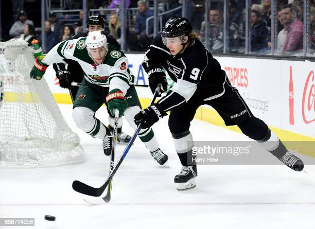 Adrian Kempe of the Los Angeles Kings makes a pass away from Mikko Koivu of the Minnesota Wild during the second period at Staples Center on December...