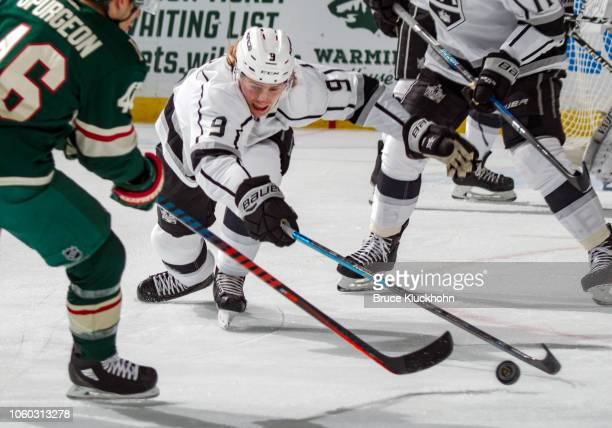 Adrian Kempe of the Los Angeles Kings reaches for a loose puck during a game between the Minnesota Wild and Los Angeles Kings at Xcel Energy Center...