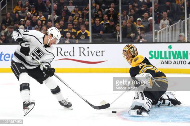 Adrian Kempe of the Los Angeles Kings scores a goal against Tuukka Rask of the Boston Bruins during the second period at TD Garden on December 17,...