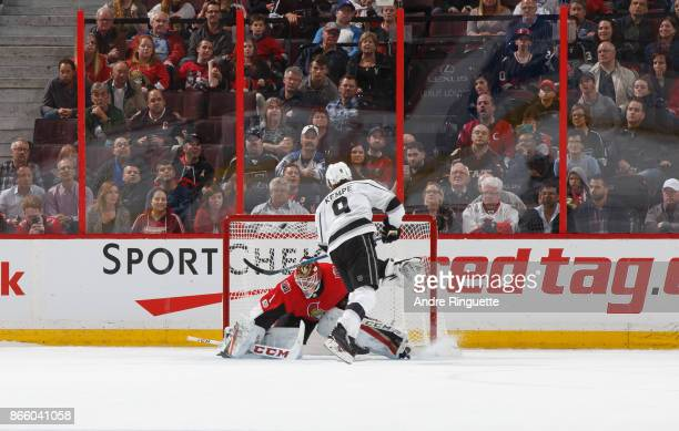 Adrian Kempe of the Los Angeles Kings scores a shootout goal against Mike Condon of the Ottawa Senators at Canadian Tire Centre on October 24 2017 in...
