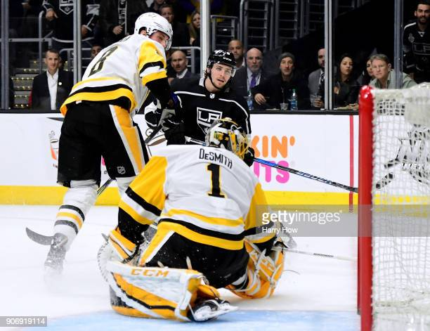 Adrian Kempe of the Los Angeles Kings scores on Casey DeSmith of the Pittsburgh Penguins in front of Brian Dumoulin to tie the game 11 during the...