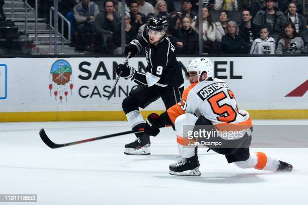 Adrian Kempe of the Los Angeles Kings shoots and scores during the first period against the Philadelphia Flyers at STAPLES Center on December 31,...