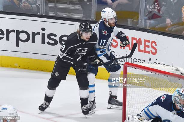 Adrian Kempe of the Los Angeles Kings skates against Adam Lowry of the Winnipeg Jets at STAPLES Center on November 22 2017 in Los Angeles California