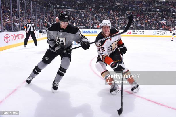 Adrian Kempe of the Los Angeles Kings skates against Josh Manson of the Anaheim Ducks at STAPLES Center on February 25 2017 in Los Angeles California