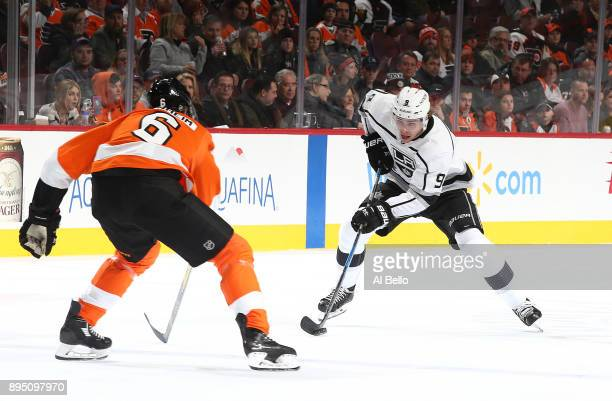 Adrian Kempe of the Los Angeles Kings skates against Travis Sanheim of the Philadelphia Flyers during their game at Wells Fargo Center on December 18...