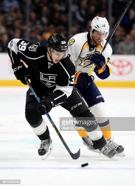 Adrian Kempe of the Los Angeles Kings skates past James Neal of the Nashville Predators during the second period of a game at Staples Center on March...