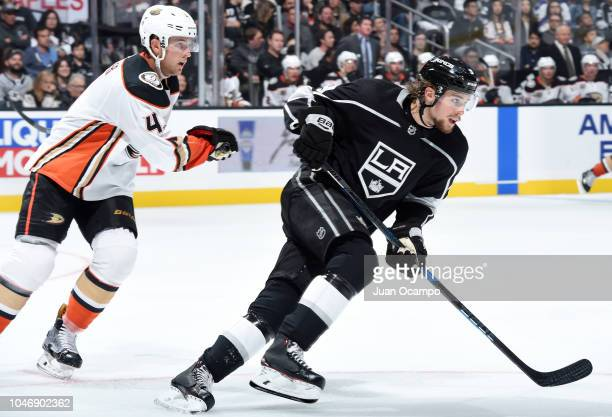 Adrian Kempe of the Los Angeles Kings skates while pursued by Cam Fowler of the Anaheim Ducks during the third period of the preseason game at...