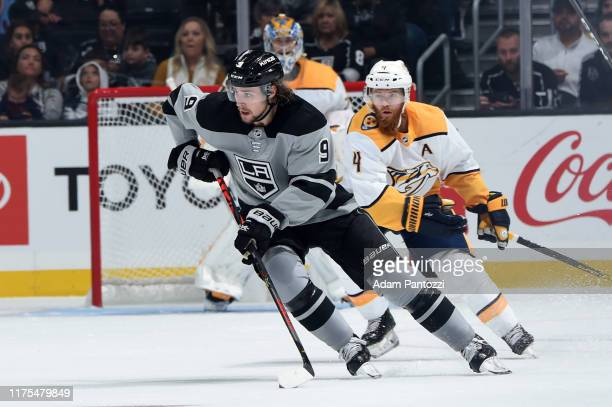 Adrian Kempe of the Los Angeles Kings skates with the puck during the second period against the Nashville Predators at STAPLES Center on October 12,...