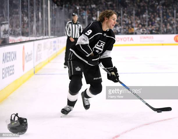 Adrian Kempe of the Los Angeles Kings skates without his helmet during the second peroid of opening night of the Los Angeles Kings 20172018 season at...