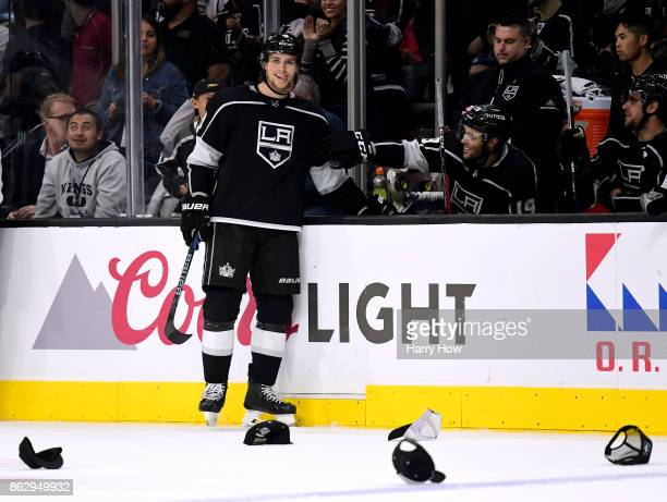 Adrian Kempe of the Los Angeles Kings smiles in front of fallen hats in reaction to his three goal hat trick for a 51 win over the Montreal Canadiens...