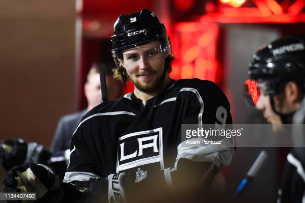 Adrian Kempe of the Los Angeles Kings smiles while waiting to take the ice for warmup before the game against the St Louis Blues at STAPLES Center on...