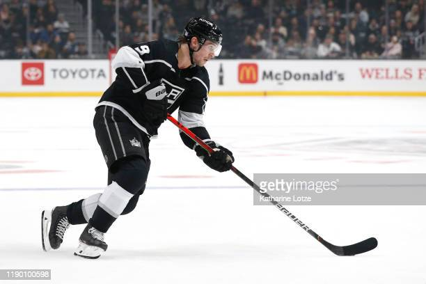 Adrian Kempe of the Los Angeles Kings takes the puck down the ice during the third period against the San Jose Sharks at Staples Center on November...