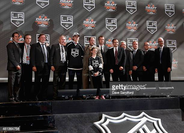 Adrian Kempe poses on stage with General Manager Dean Lombardi Assistant General Manager Rob Blake Director of Player Personell Mike Futa Director of...